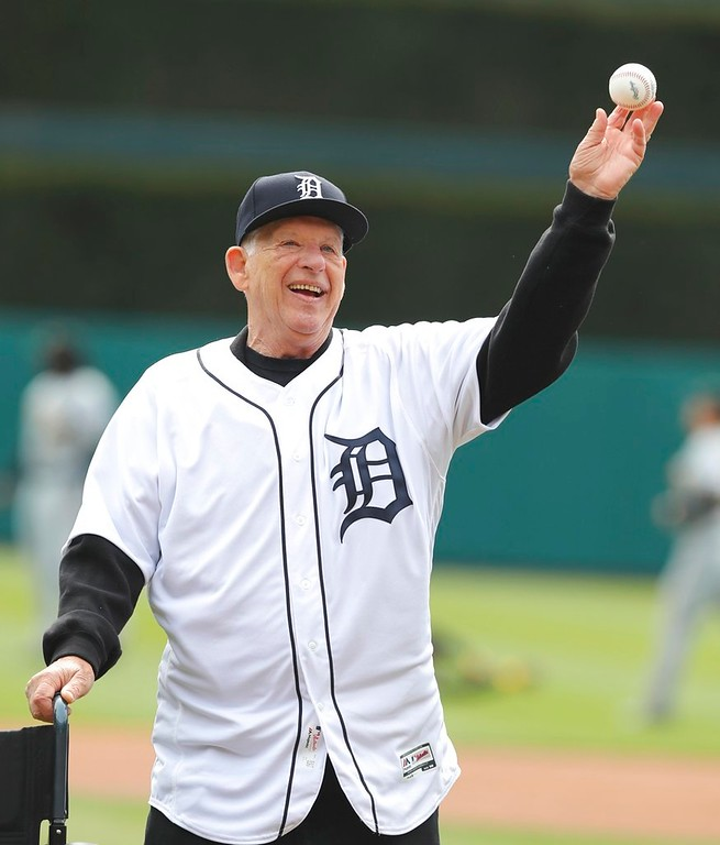 . Former Detroit Tigers pitcher Mickey Lolich throws out the ceremonial first pitch before a baseball game between the Tigers and the Pittsburgh Pirates, Friday, March 30, 2018, in Detroit. (AP Photo/Carlos Osorio)