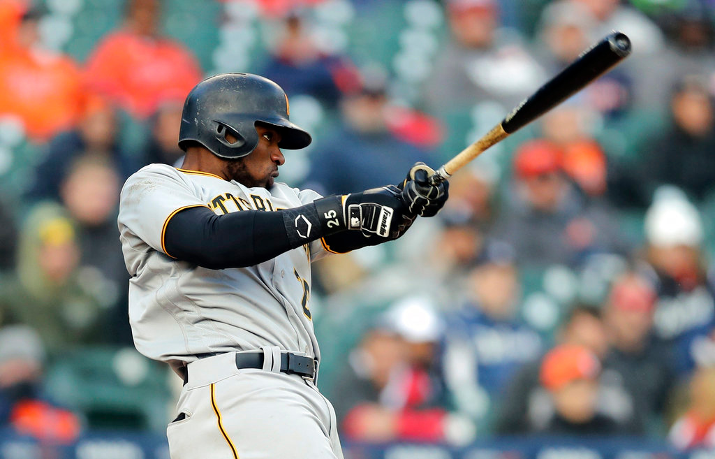 . Pittsburgh Pirates\' Gregory Polanco connects for a three-run home run during the 13th inning of a baseball game against the Detroit Tigers, Friday, March 30, 2018, in Detroit. (AP Photo/Carlos Osorio)
