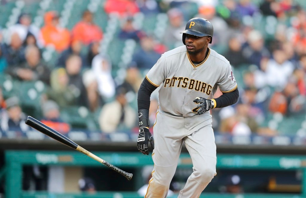 . Pittsburgh Pirates\' Gregory Polanco tosses his bat after his three-run home run during the 13th inning of a baseball game against the Detroit Tigers, Friday, March 30, 2018, in Detroit. (AP Photo/Carlos Osorio)