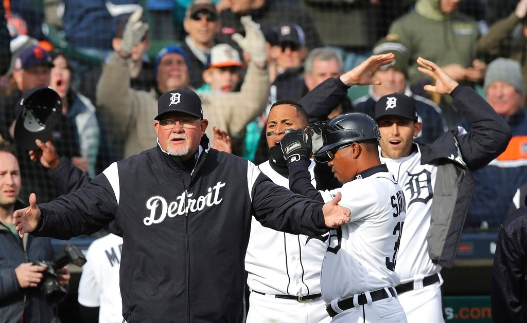 . The Detroit Tigers react after a review of a play was overturned during the 10th inning of a baseball game against the Pittsburgh Pirates, Friday, March 30, 2018, in Detroit. Tigers\' Nicholas Castellanos was initially called safe at home. (AP Photo/Carlos Osorio)