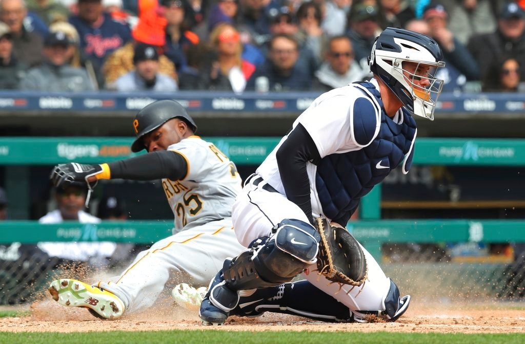 . Pittsburgh Pirates\' Gregory Polanco beats the throw to Detroit Tigers catcher James McCann to score on an RBI single by teammate Corey Dickerson during the fourth inning of a baseball game, Friday, March 30, 2018, in Detroit. (AP Photo/Carlos Osorio)