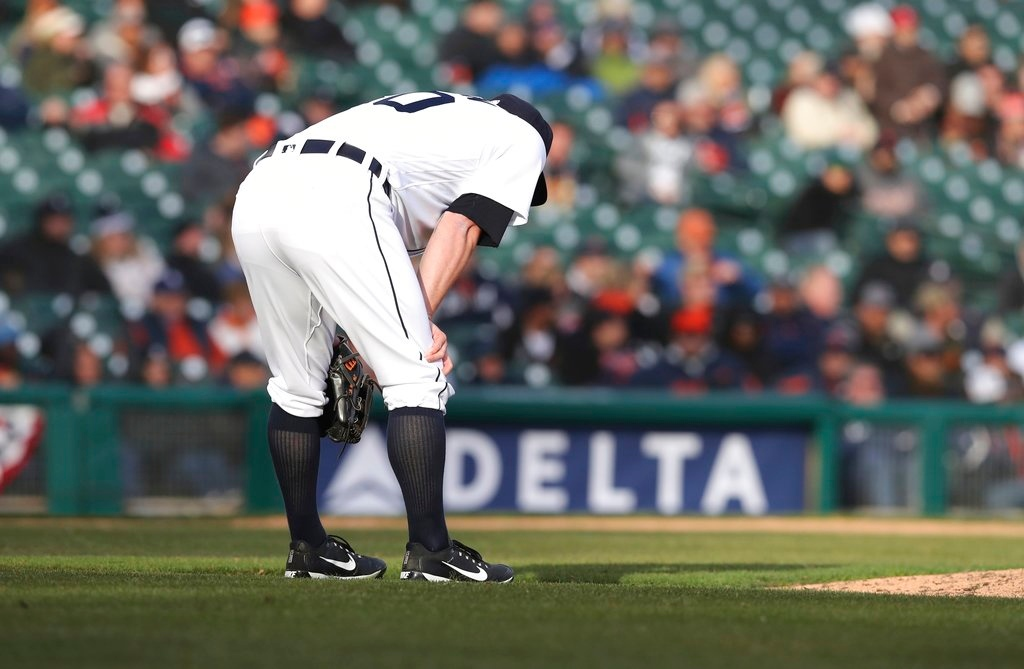 . Detroit Tigers relief pitcher Alex Wilson reacts after giving up a three-run home run to Pittsburgh Pirates\' Gregory Polanco during the 13th inning of a baseball game, Friday, March 30, 2018, in Detroit. (AP Photo/Carlos Osorio)