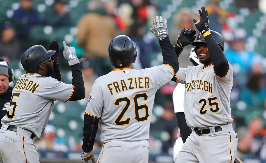 . Pittsburgh Pirates\' Gregory Polanco is greeted by teammates Adam Frazier (26) and Josh Harrison after they scored on Polanco\'s three-run home run during the 13th inning of a baseball game against the Detroit Tigers, Friday, March 30, 2018, in Detroit. (AP Photo/Carlos Osorio)