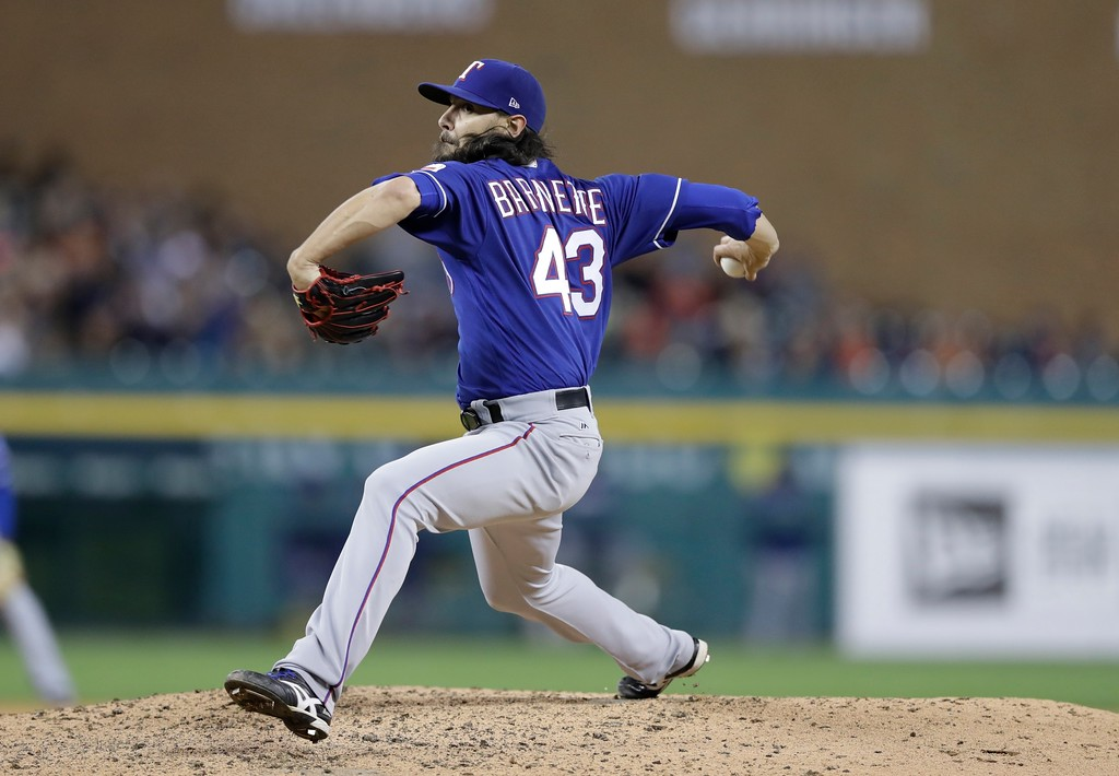 . Texas Rangers relief pitcher Tony Barnette throws during the sixth inning of a baseball game against the Detroit Tigers, Friday, May 19, 2017, in Detroit. (AP Photo/Carlos Osorio)