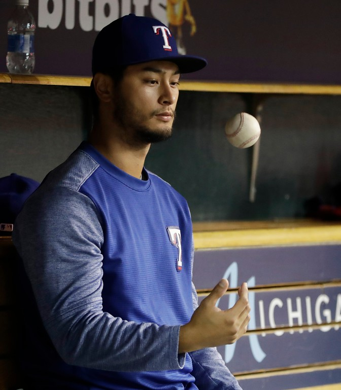 . Texas Rangers pitcher Yu Darvish tosses a ball during the fifth inning of the team\'s baseball game against the Detroit Tigers, Friday, May 19, 2017, in Detroit. Dervish is scheduled to start Sunday night\'s game. (AP Photo/Carlos Osorio)