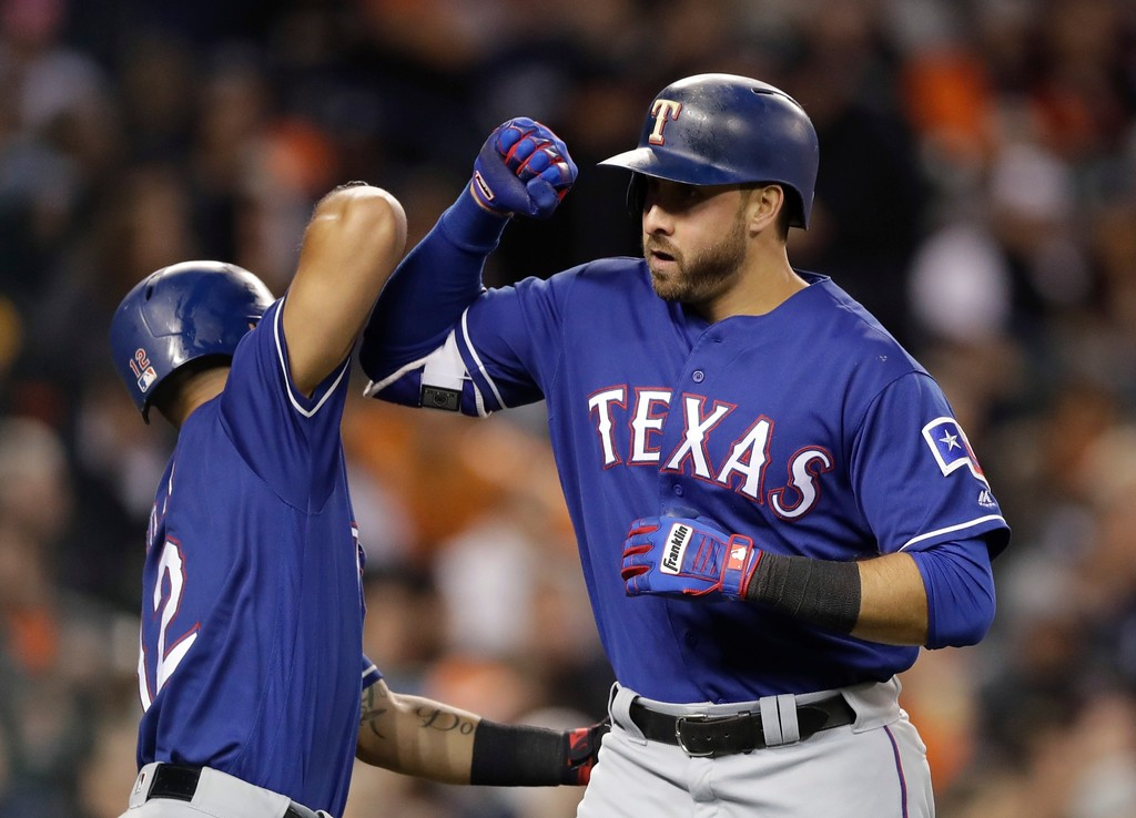 . Texas Rangers\' Joey Gallo is greeted by Rougned Odor after hitting a two-run home run during the sixth inning of a baseball game against the Detroit Tigers, Friday, May 19, 2017, in Detroit. (AP Photo/Carlos Osorio)