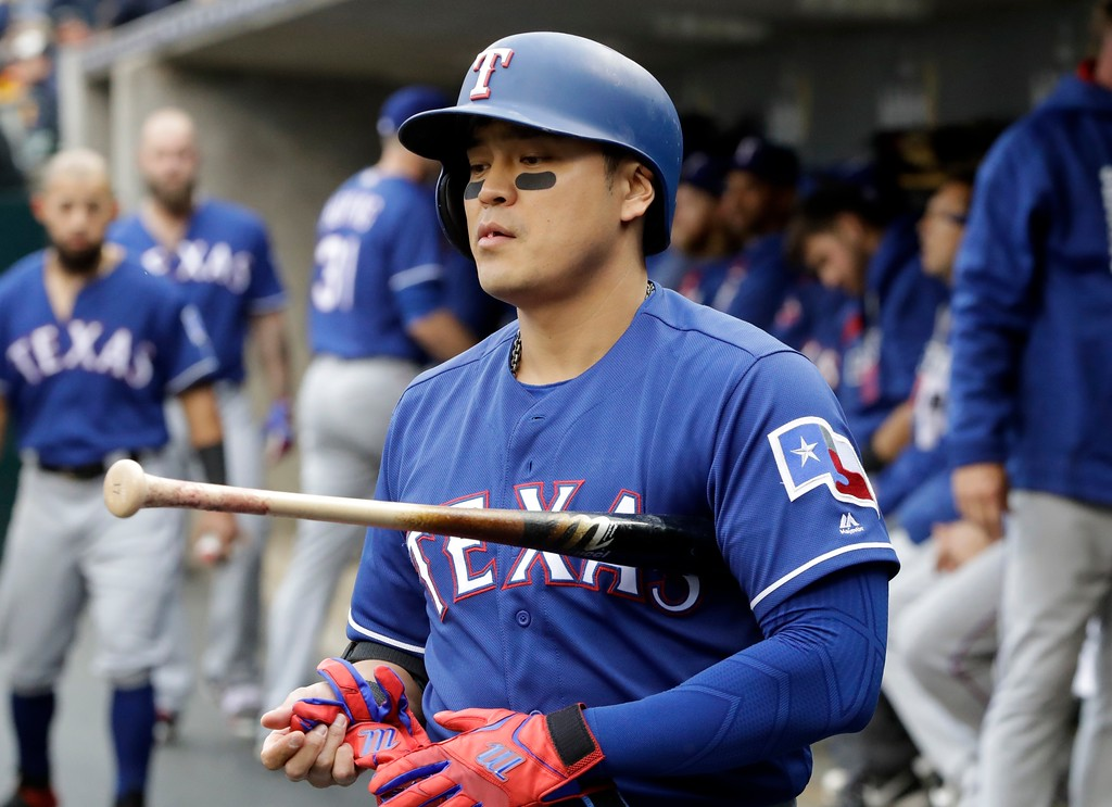 . Texas Rangers designated hitter Shin-Soo Choo walks to the batter\'s box during the first inning of a baseball game against the Detroit Tigers, Friday, May 19, 2017, in Detroit. (AP Photo/Carlos Osorio)