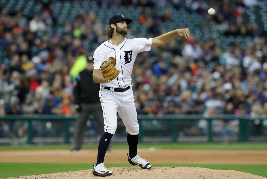 . Detroit Tigers starting pitcher Daniel Norris throws to first during the third inning of a baseball game against the Texas Rangers, Friday, May 19, 2017, in Detroit. (AP Photo/Carlos Osorio)