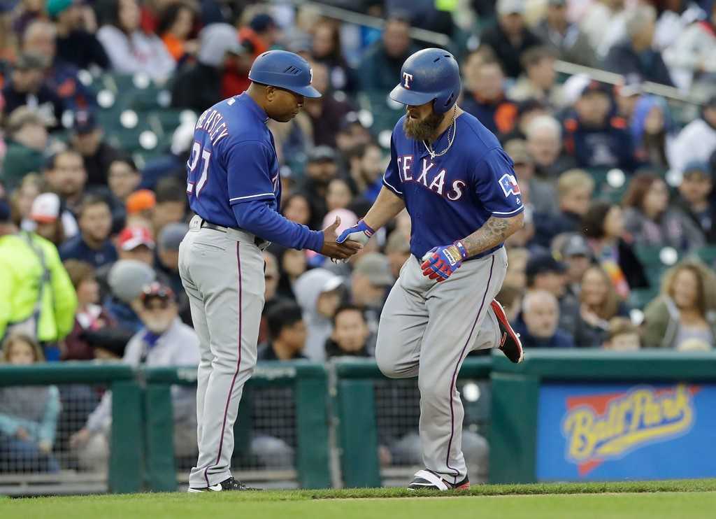 . Texas Rangers\' Mike Napoli, right, rounds the bases after a solo home run during the fourth inning of a baseball game against the Detroit Tigers, Friday, May 19, 2017, in Detroit. (AP Photo/Carlos Osorio)