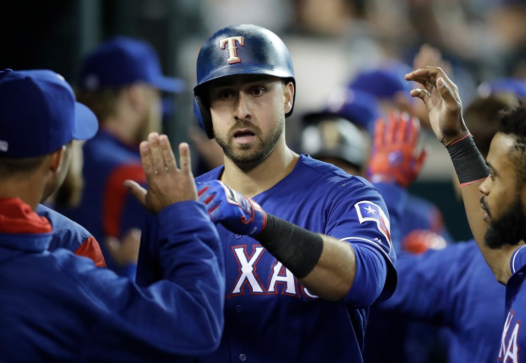 . Texas Rangers\' Joey Gallo is greeted by teammates after hitting a two-run home run during the sixth inning of the team\'s baseball game against the Detroit Tigers, Friday, May 19, 2017, in Detroit. (AP Photo/Carlos Osorio)