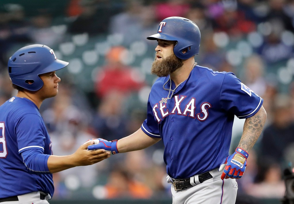 . Texas Rangers\' Mike Napoli, right, is greeted by the ballboy after a solo home run during the fourth inning of a baseball game against the Detroit Tigers, Friday, May 19, 2017, in Detroit. (AP Photo/Carlos Osorio)