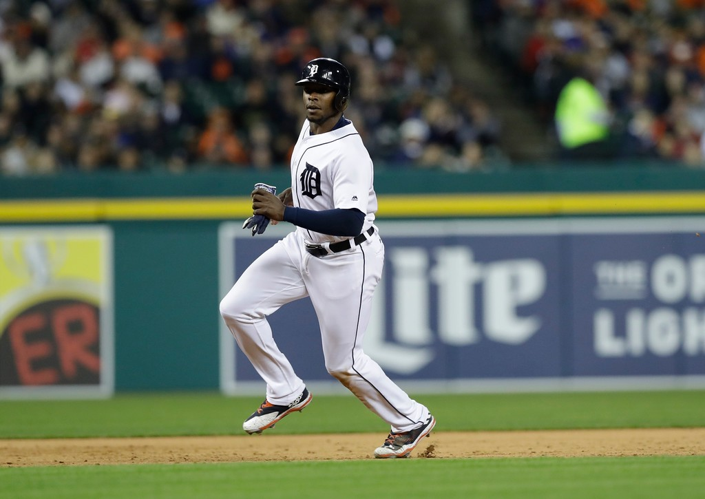 . Detroit Tigers\' Justin Upton runs to third during the sixth inning of a baseball game against the Texas Rangers, Friday, May 19, 2017, in Detroit. (AP Photo/Carlos Osorio)