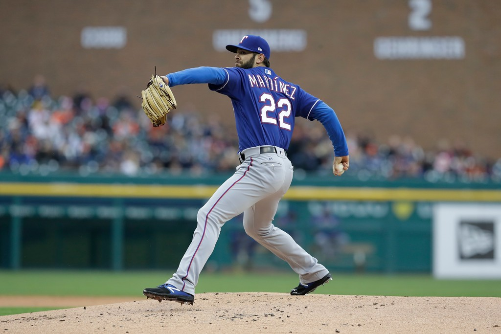 . Texas Rangers starting pitcher Nick Martinez throw during the first inning of a baseball game against the Detroit Tigers, Friday, May 19, 2017, in Detroit. (AP Photo/Carlos Osorio)