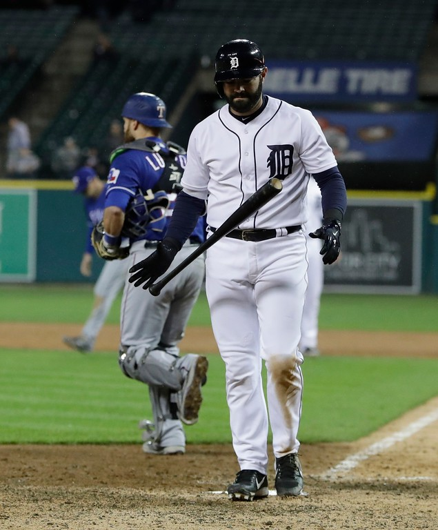 . Detroit Tigers catcher Alex Avila walks back to the dugout after striking out to end the ninth inning of a baseball game against the Texas Rangers, Friday, May 19, 2017, in Detroit. (AP Photo/Carlos Osorio)
