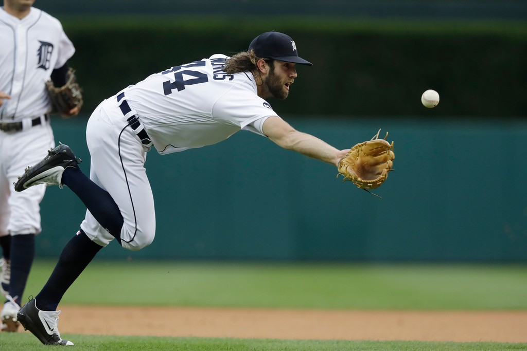 . Detroit Tigers starting pitcher Daniel Norris fields a ball hit by Texas Rangers\' Shin-Soo Choo and tosses to first for the out during the first inning of a baseball game, Friday, May 19, 2017, in Detroit. (AP Photo/Carlos Osorio)