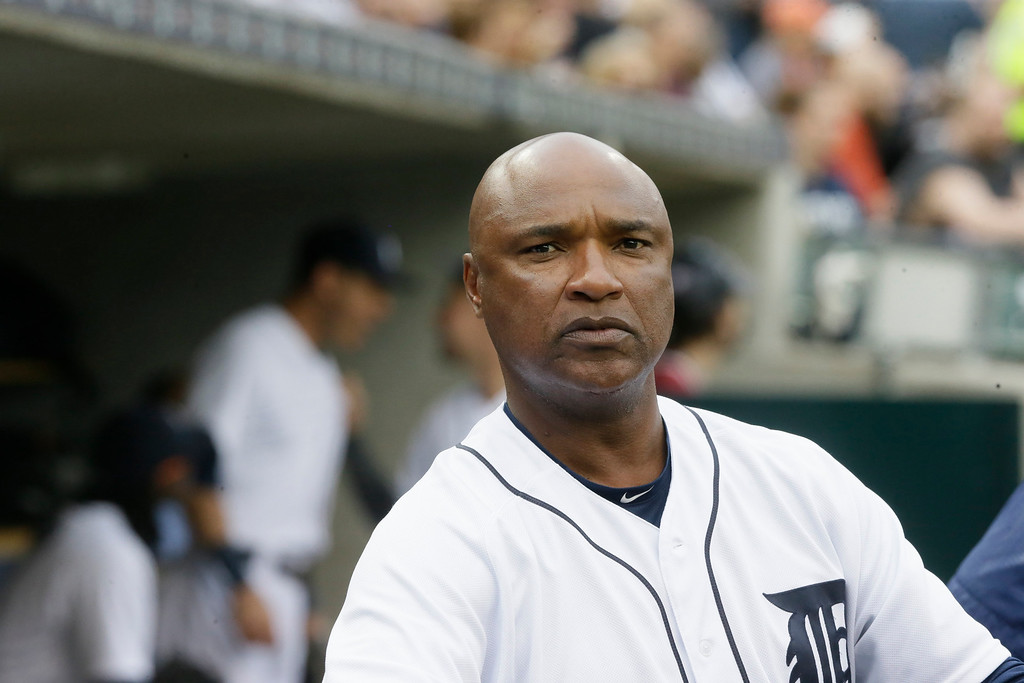 . Detroit Tigers third base coach Dave Clark is seen in the dugout during the first inning of a baseball game against the Tampa Bay Rays, Friday, May 20, 2016, in Detroit. (AP Photo/Carlos Osorio)
