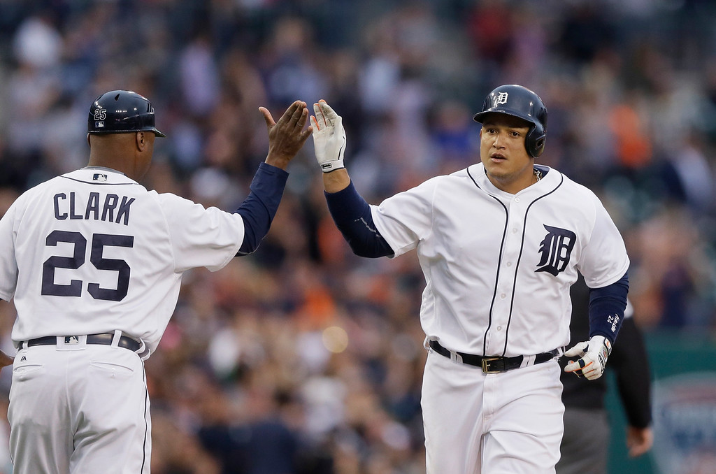 . Detroit Tigers\' Miguel Cabrera, right, is congratulated by third base coach Dave Clark after his two-run home run off Tampa Bay Rays pitcher Matt Andriese during the third inning of a baseball game, Friday, May 20, 2016, in Detroit. (AP Photo/Carlos Osorio)