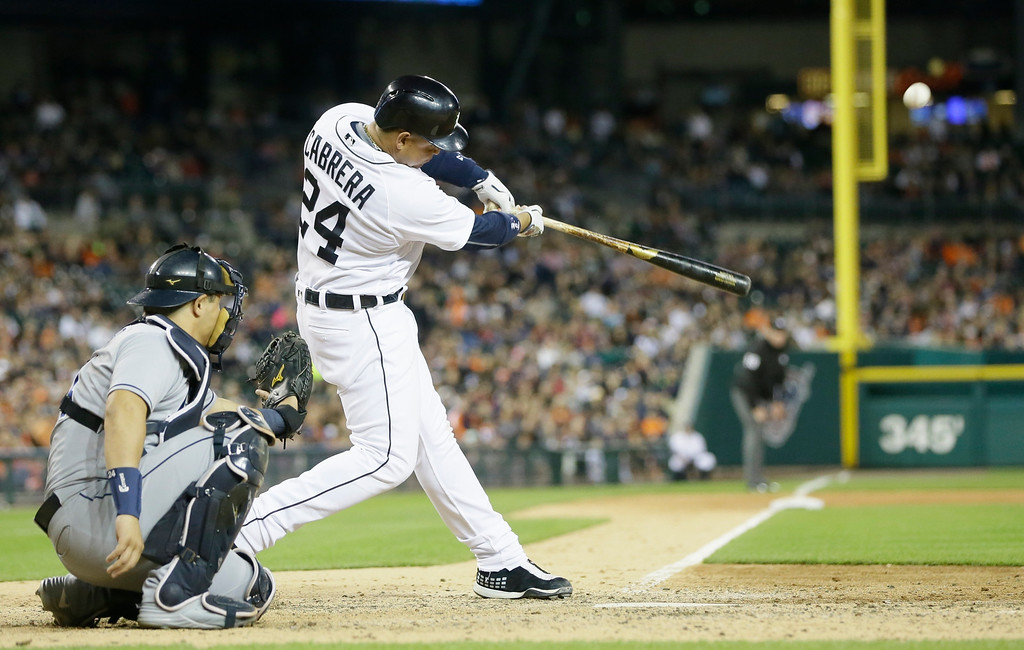 . Detroit Tigers\' Miguel Cabrera connects for a solo home run during the seventh inning of a baseball game against the Tampa Bay Rays, Friday, May 20, 2016, in Detroit. (AP Photo/Carlos Osorio)