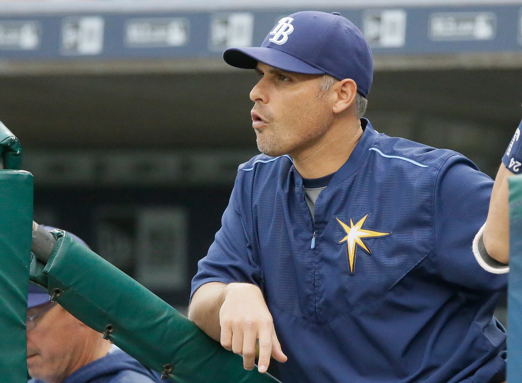 . Tampa Bay Rays manager Kevin Cash looks out from the dugout during the first inning of a baseball game against the Detroit Tigers, Friday, May 20, 2016, in Detroit. (AP Photo/Carlos Osorio)