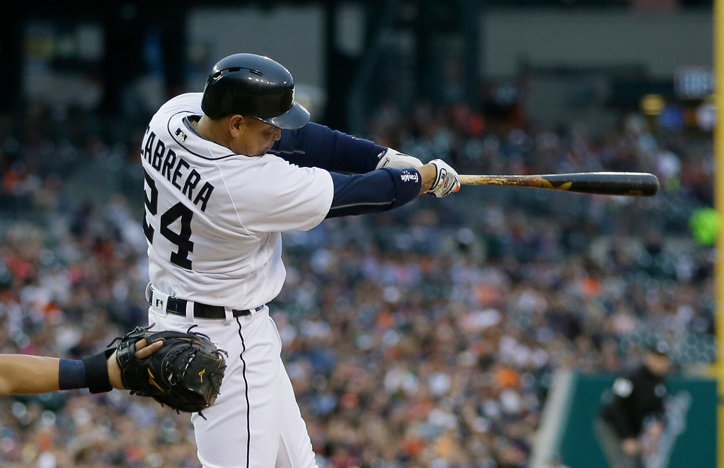 . Detroit Tigers\' Miguel Cabrera connects for a two-run home run during the third inning of a baseball game against the Tampa Bay Rays, Friday, May 20, 2016, in Detroit. (AP Photo/Carlos Osorio)