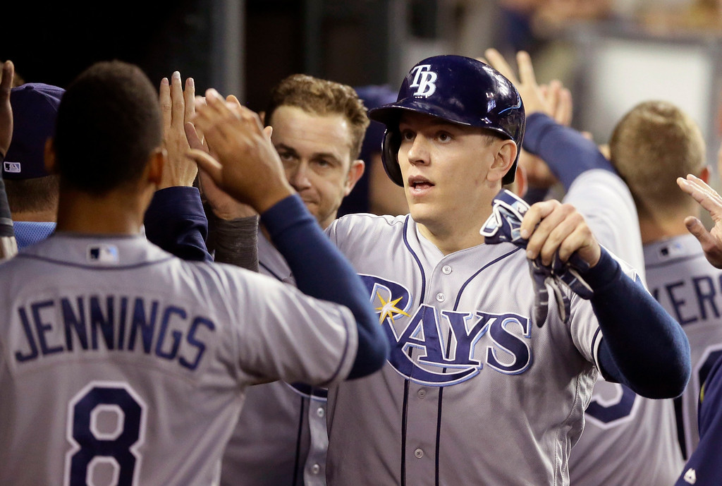. Tampa Bay Rays\' Logan Morrison high fives teammates after scoring during the sixth inning of a baseball game against the Detroit Tigers, Friday, May 20, 2016, in Detroit. (AP Photo/Carlos Osorio)