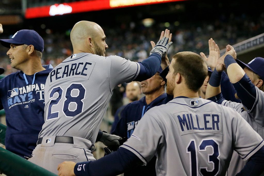 . Tampa Bay Rays\' Steve Pearce is greeted by teammates after hitting a solo home run during the eighth inning of a baseball game against the Detroit Tigers Friday, May 20, 2016, in Detroit. (AP Photo/Carlos Osorio)