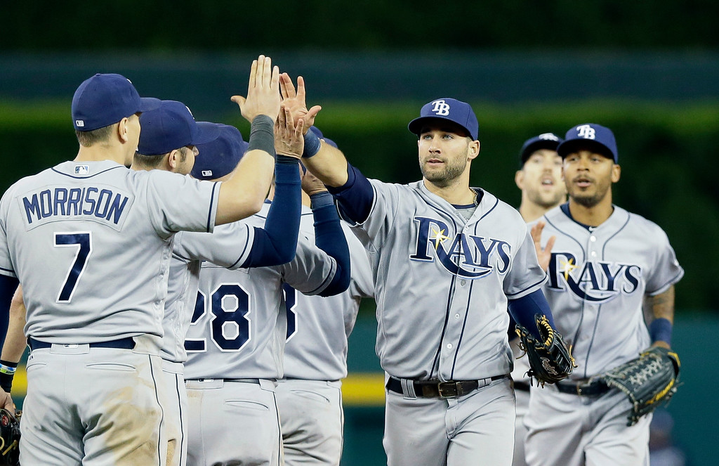 . Tampa Bay Rays center fielder Kevin Kiermaier, center, leads teammates after their 7-5 win over the Detroit Tigers in a baseball game, Friday, May 20, 2016, in Detroit. (AP Photo/Carlos Osorio)