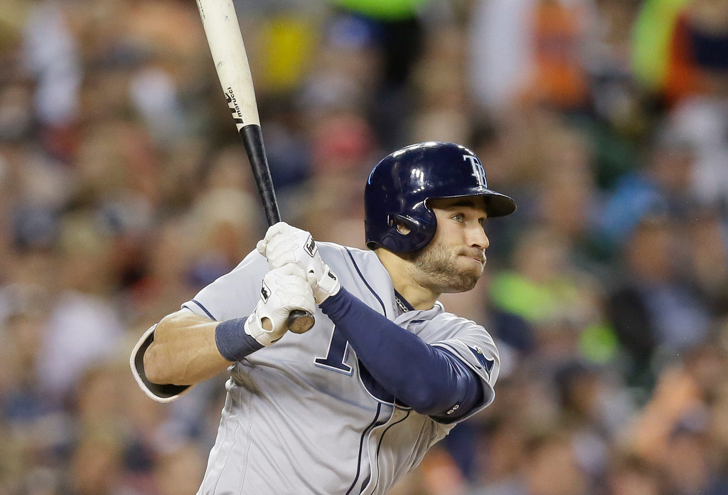 . Tampa Bay Rays\' Kevin Kiermaier connects for a three-run triple to right field during the sixth inning of a baseball game against the Detroit Tigers, Friday, May 20, 2016, in Detroit. (AP Photo/Carlos Osorio)