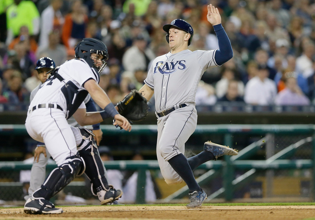 . Detroit Tigers catcher James McCann waits on the throw as Tampa Bay Rays\' Logan Morrison prepares to slide during the sixth inning of a baseball game, Friday, May 20, 2016, in Detroit. (AP Photo/Carlos Osorio)