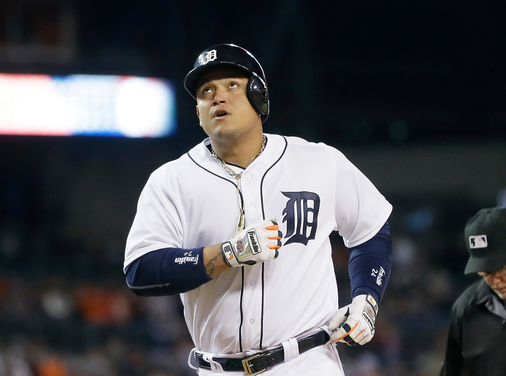 . Detroit Tigers\' Miguel Cabrera looks skyward after crossing home plate on his solo home run during the seventh inning of a baseball game against the Tampa Bay Rays, Friday, May 20, 2016, in Detroit. (AP Photo/Carlos Osorio)