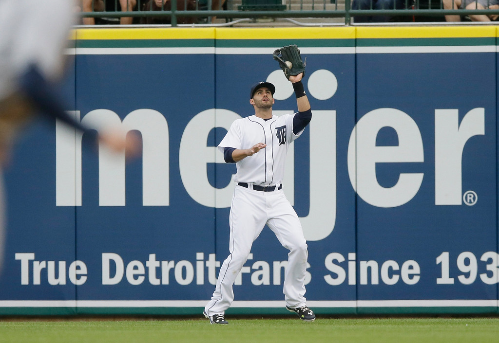 . Detroit Tigers right fielder J.D. Martinez catches the fly out hit by Tampa Bay Rays\' Steve Pearce during the first inning of a baseball game, Friday, May 20, 2016, in Detroit. (AP Photo/Carlos Osorio)