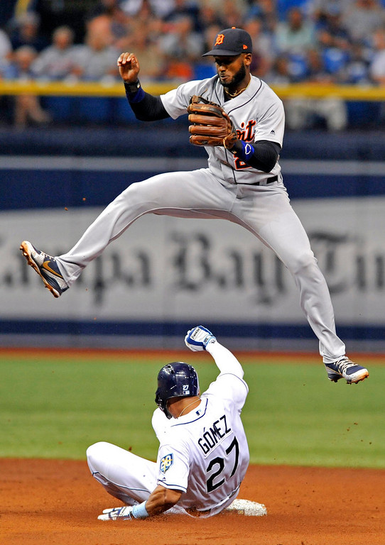 . Tampa Bay Rays\' Carlos Gomez (27) steals second base beneath a high throw to Detroit Tigers\' Niko Goodrum during the third inning of a baseball game Tuesday, July 10, 2018, in St. Petersburg, Fla. (AP Photo/Steve Nesius)