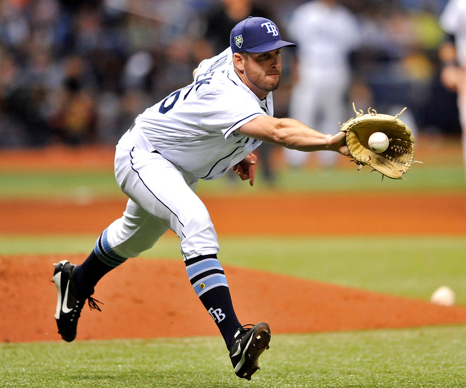. Tampa Bay Rays reliever Adam Kolarek fields a ground ball hit by Detroit Tigers\' Niko Goodrum during the seventh inning of a baseball game Tuesday, July 10, 2018, in St. Petersburg, Fla. Kolarek made the play and Goodrum was out at first base. (AP Photo/Steve Nesius)