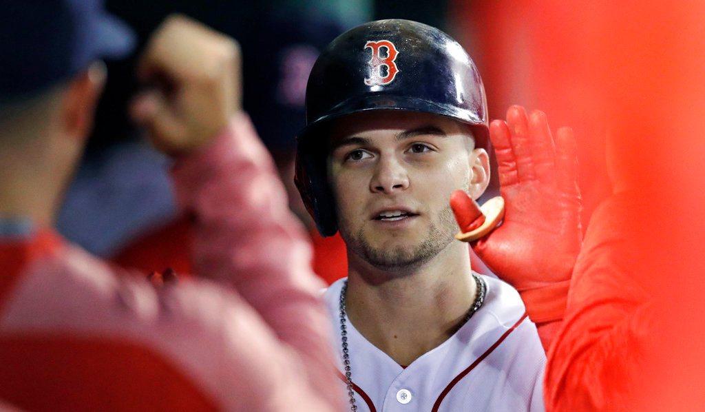 . Boston Red Sox\'s Andrew Benintendi is congratulated by teammates after his solo home run off Detroit Tigers relief pitcher Blaine Hardy during the fourth inning of a baseball game at Fenway Park in Boston, Wednesday, June 6, 2018. (AP Photo/Charles Krupa)