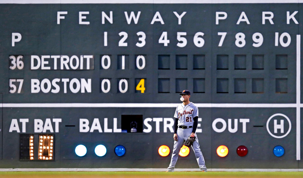 . Detroit Tigers left fielder JaCoby Jones (21) blows a bubble while waiting for a pitch to be delivered while trailing the Boston Red Sox during the third inning of a baseball game at Fenway Park in Boston, Wednesday, June 6, 2018. (AP Photo/Charles Krupa)