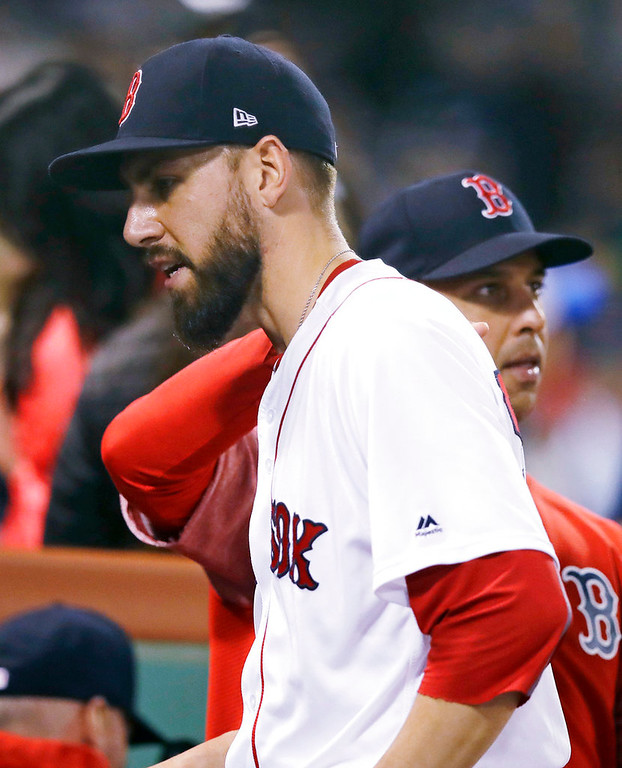 . Boston Red Sox relief pitcher Matt Barnes gets a pat on the back from manager Alex Cora, rear, after getting Detroit Tigers\' James McCann to ground out with the bases loadedl ending the top of the seventh inning of a baseball game at Fenway Park in Boston, Wednesday, June 6, 2018. (AP Photo/Charles Krupa)