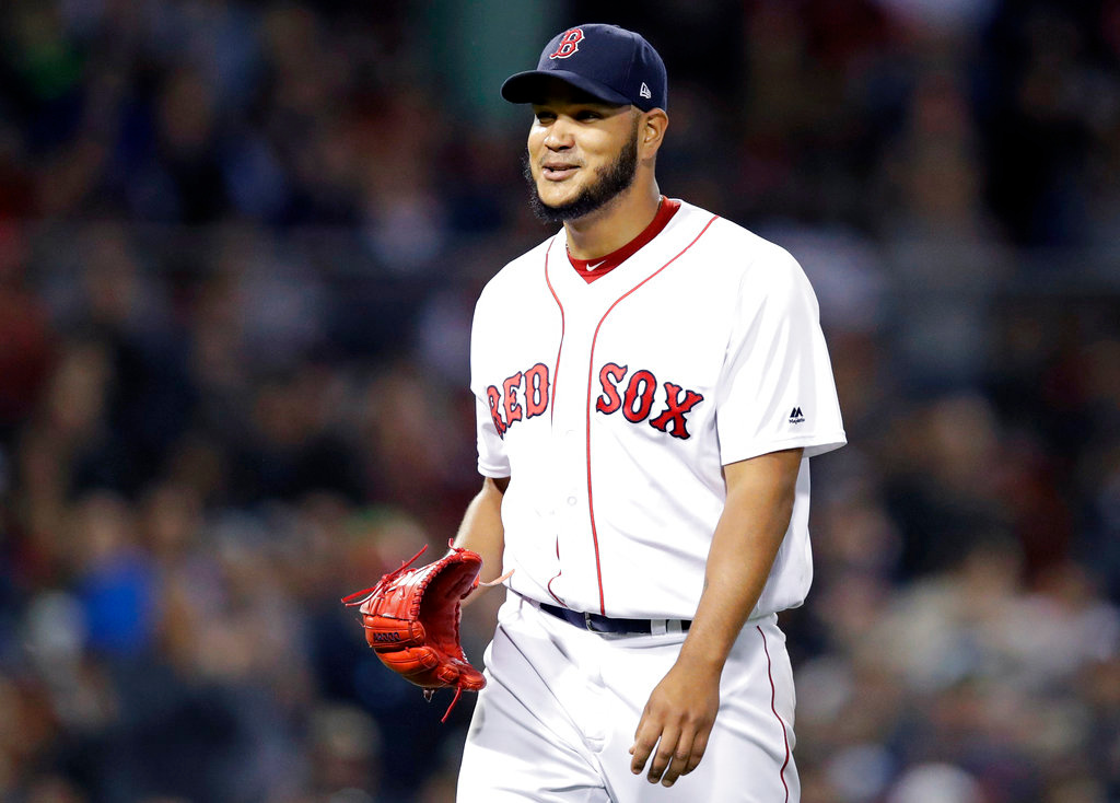 . Boston Red Sox starting pitcher Eduardo Rodriguez smiles as he heads to the dugout after being taken out of the baseball game during the sixth inning against the Detroit Tigers at Fenway Park in Boston, Wednesday, June 6, 2018. Rodriquez allowed one run on five hits in his outing. (AP Photo/Charles Krupa)