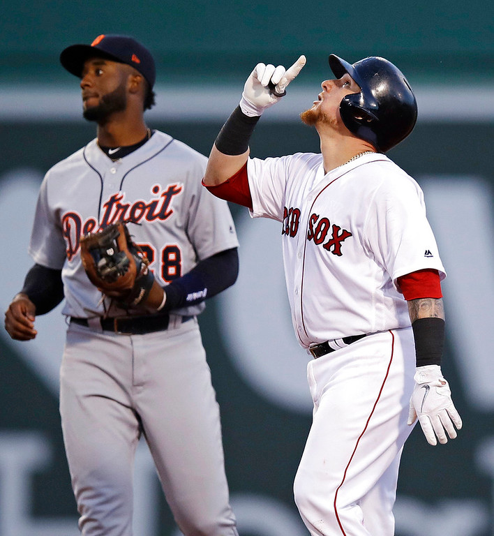 . Boston Red Sox\'s Christian Vazquez, right, points upwards as he stands on second base after his RBI double during the third inning of a baseball game against the Detroit Tigers at Fenway Park in Boston, Wednesday, June 6, 2018. At left is Detroit Tigers shortstop Niko Goodrum. (AP Photo/Charles Krupa)