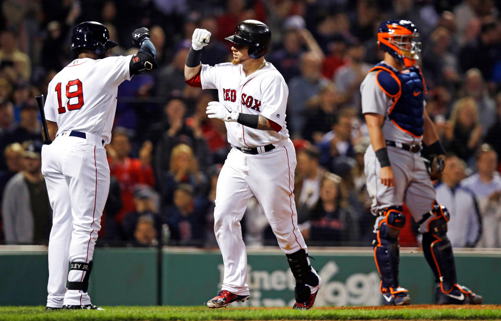 . Boston Red Sox\'s Christian Vazquez, center, is congratulated by Jackie Bradley Jr. (19) after his solo home run during the seventh inning of a baseball game against the Detroit Tigers at Fenway Park in Boston, Wednesday, June 6, 2018. At right is Tigers catcher James McCann. (AP Photo/Charles Krupa)