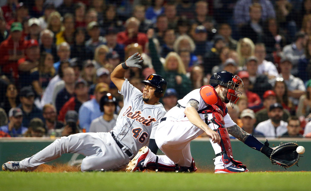 . Detroit Tigers\' Jeimer Candelario (46) slides into home to score on a single by Jose Iglesias as Boston Red Sox catcher Blake Swihart catches the throw during the eighth inning of a baseball game at Fenway Park, Thursday, June 7, 2018, in Boston. (AP Photo/Elise Amendola)