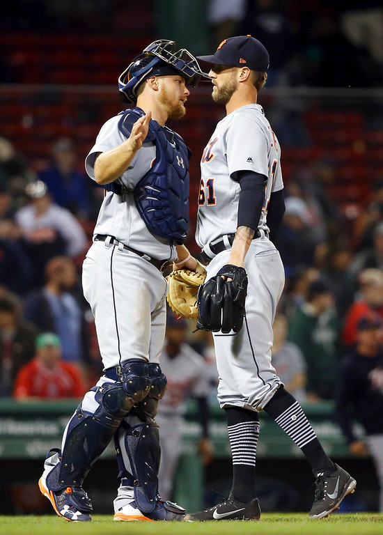 . Detroit Tigers closer Shane Greene and catcher John Hicks chest-bump to celebrate the Tigers\' 7-2 victory over the Boston Red Sox in a baseball game at Fenway Park, Thursday, June 7, 2018, in Boston. (AP Photo/Elise Amendola)