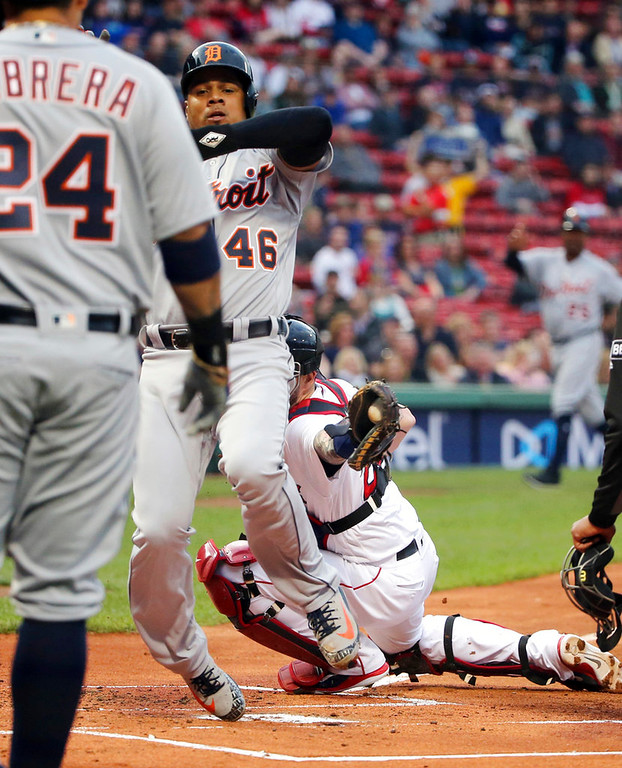 . Detroit Tigers\' Jeimer Candelario (46) scores past the tag of Boston Red Sox catcher Blake Swihart on a single by John Hicks during the first inning of a baseball game at Fenway Park, Thursday, June 7, 2018, in Boston. (AP Photo/Elise Amendola)