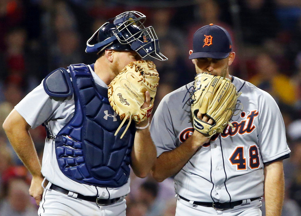 . Detroit Tigers pitcher Matthew Boyd (48) and catcher John Hicks have a mound conference during a baseball game against the Boston Red Sox at Fenway Park, Thursday, June 7, 2018, in Boston. (AP Photo/Elise Amendola)