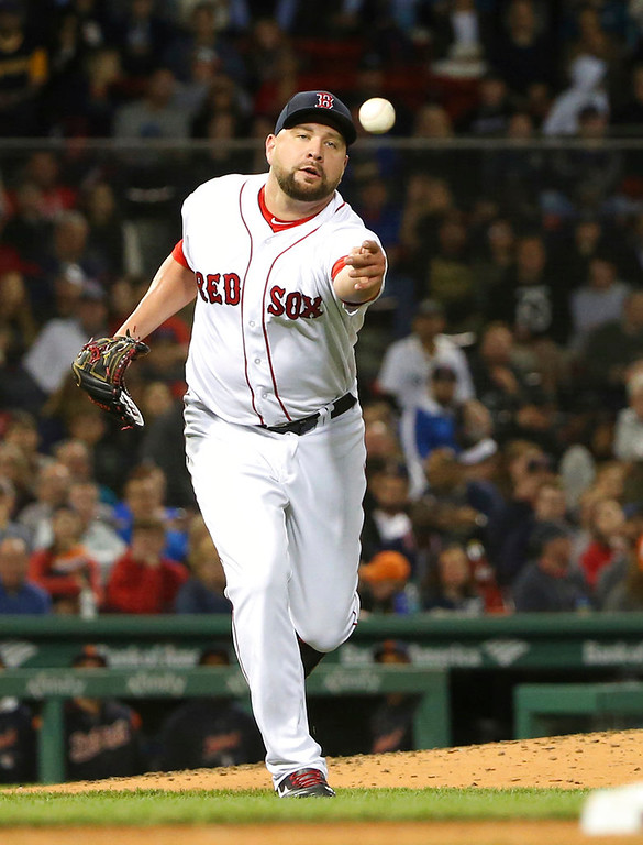 . Boston Red Sox relief pitcher Brian Johnson tosses the ball to first during a baseball game against the Detroit Tigers at Fenway Park, Thursday, June 7, 2018, in Boston. (AP Photo/Elise Amendola)