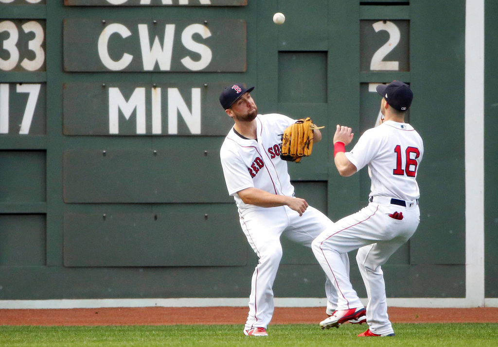 . Boston Red Sox center fielder Andrew Benintendi (16) plays a double off the wall by Detroit Tigers\' Nicholas Castellanos as left fielder Sam Travis watches during the first inning of a baseball game at Fenway Park, Thursday, June 7, 2018, in Boston. (AP Photo/Elise Amendola)