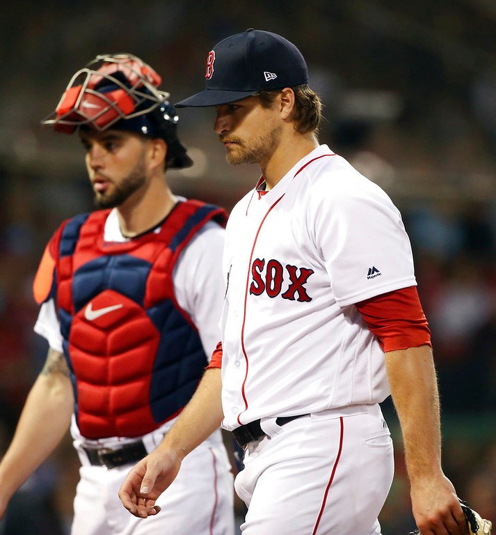 . Boston Red Sox starting pitcher Jalen Beeks walks from the mound with catcher Blake Swihart after the fourth inning of a baseball game against the Detroit Tigers at Fenway Park, Thursday, June 7, 2018, in Boston. (AP Photo/Elise Amendola)