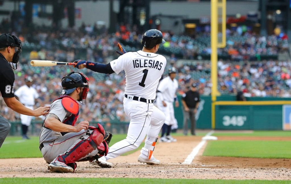 . Detroit Tigers\' Jose Iglesias follows through on a two-run home run during the sixth inning of the team\'s baseball game against the Boston Red Sox, Saturday, July 21, 2018, in Detroit. (AP Photo/Carlos Osorio)