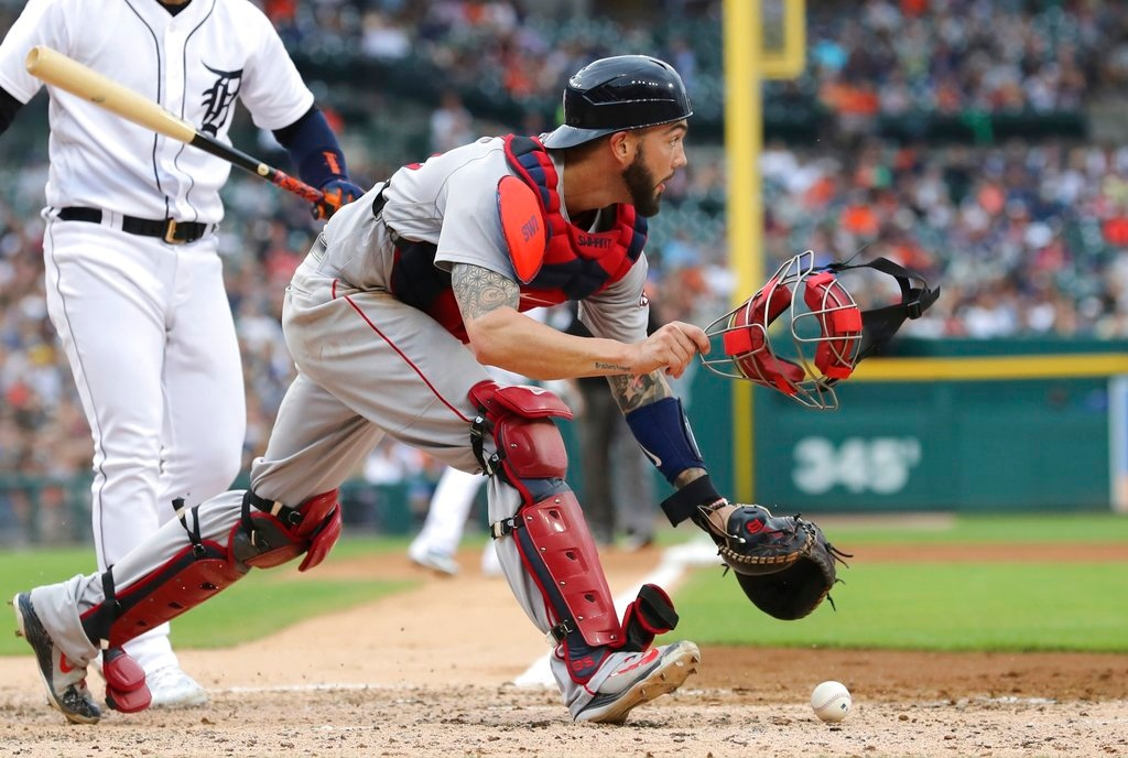 . Boston Red Sox catcher Blake Swihart chases the loose ball as Detroit Tigers\' Jose Iglesias bats during the fourth inning of a baseball game, Saturday, July 21, 2018, in Detroit. (AP Photo/Carlos Osorio)