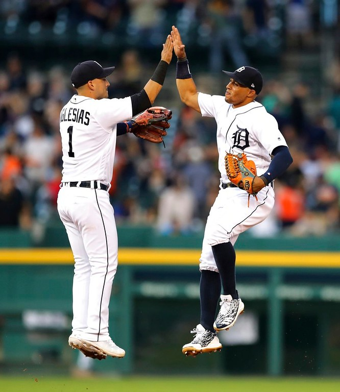 . Detroit Tigers shortstop Jose Iglesias (1) and center fielder Leonys Martin celebrate a win over the Boston Red Sox in a baseball game, Saturday, July 21, 2018, in Detroit. (AP Photo/Carlos Osorio)