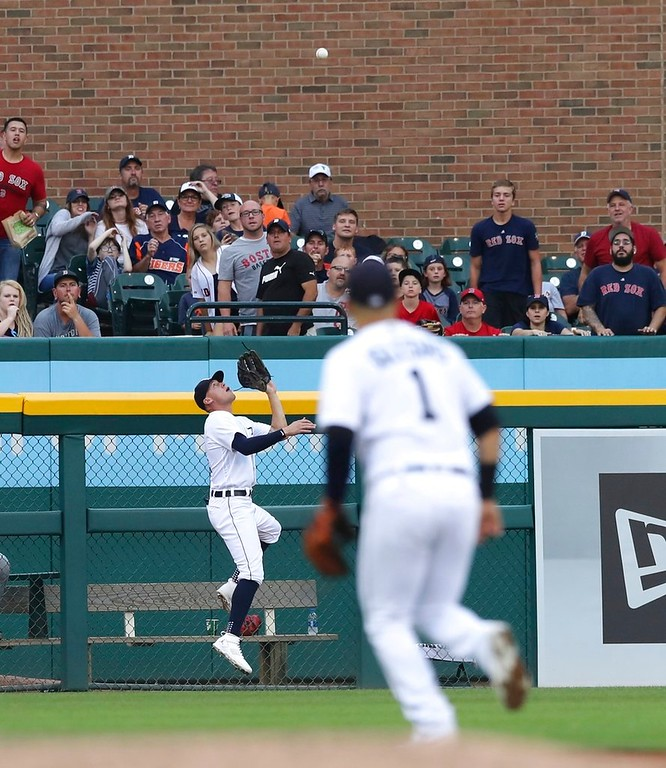 . Detroit Tigers center fielder JaCoby Jones catches the fly out hit by Boston Red Sox\'s Jackie Bradley Jr. at the fence during the sixth inning of a baseball game, Saturday, July 21, 2018, in Detroit. (AP Photo/Carlos Osorio)